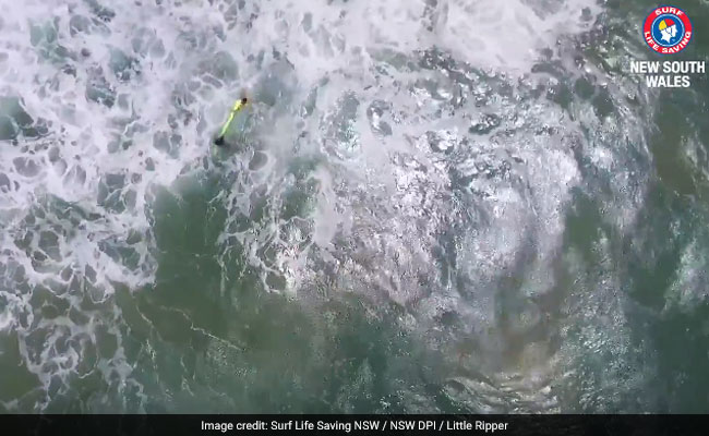 Watch: Rough Seas, 2 Swimmers And A Rescue By Drone