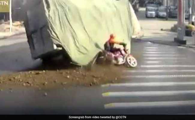 Lorry Carrying Stones Flips Over. Biker's Close Shave Caught On Film