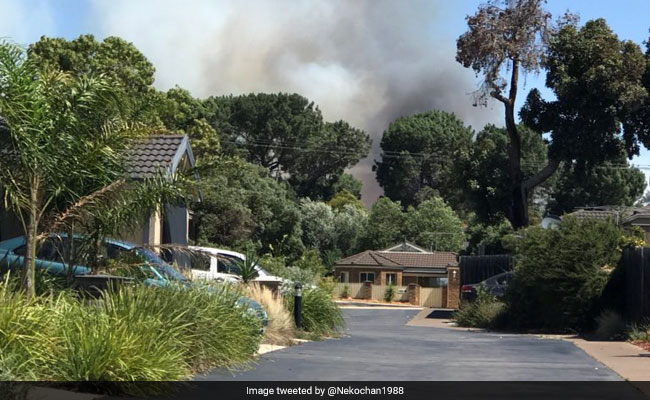 Bushfires Destroy Buildings In Australia As Heatwave Melts Highway