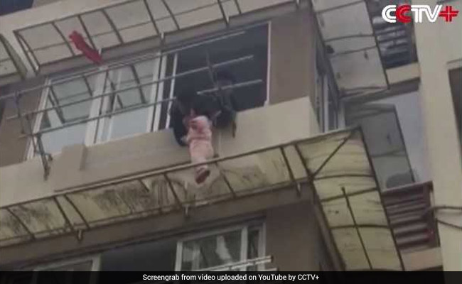 Video: Man Risks Life To Save Child Hanging From Third Floor Ledge