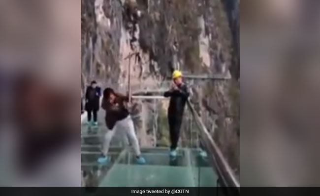 Watch: 600 Feet In The Sky, Workers Smash Glass Bridge