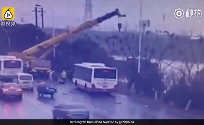 Watch: Crane Driver Rescues Passengers After Bus Falls Into River