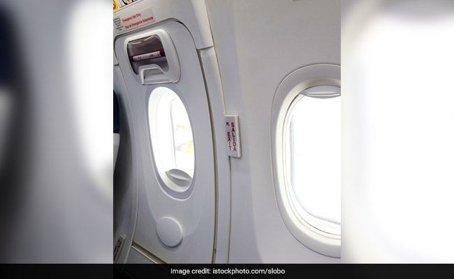 Tired Of Waiting, Passenger Uses Emergency Exit, Sits On Wing