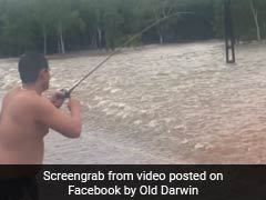 Man Goes Fishing On Flooded Road. Watch The Moment He Landed A Catch