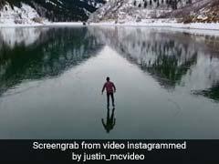 Viral Video: 'बर्फ की नदी' पर दौड़ता दिखा ये शख्स, देखने वालों के उड़ गए होश