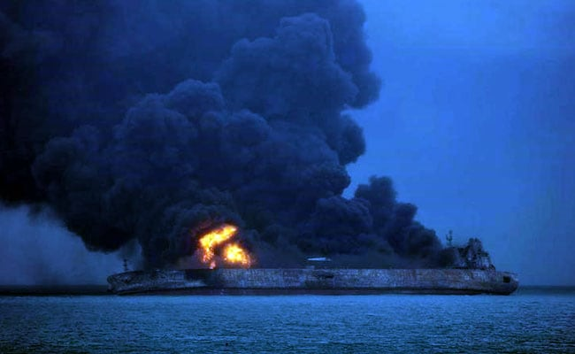 Body found as tanker fire still rages following sea collision