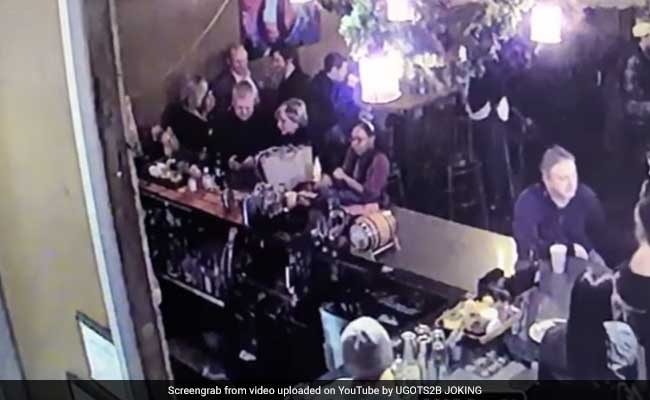 Video Shows Police Officer Hitting His Wife At Bar With Cellphone