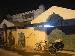 Official Removed After Repainting Saffron Wall Of Haj Complex in Uttar Pradesh