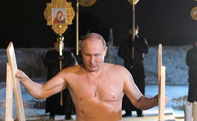 ICE COOL PUTIN? Russian leader plunges into freezing lake in freakish ceremony