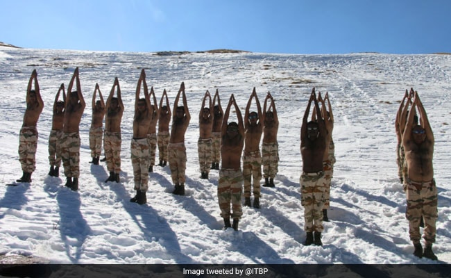 Indo-Tibetan Border Police Soldiers Do Yoga In The Himalayas. See Pics