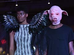 #MeToo Themed New York Fashion Show Opens With Angel Wing Models, Pig-Faced Men