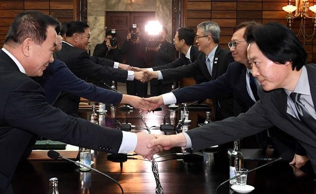 north korean and south korean deligates reuters