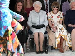 Queen Elizabeth II Adds A Royal Touch To The Front Row Of London Fashion Week