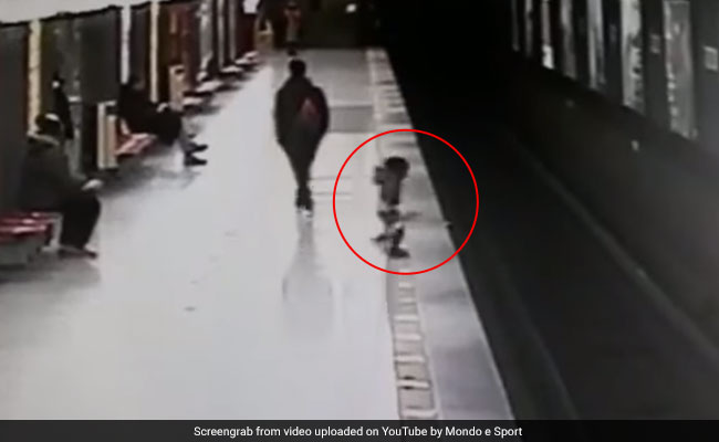 Video: Train Just A Minute Away, Child Falls On Tracks. Saved By Stranger
