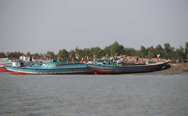 Ferries that carry construction materials at Vashan Char previously known as Thengar Char island