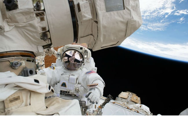 U.S. and Japanese astronauts conduct spacewalk to fix robot arm on ISS