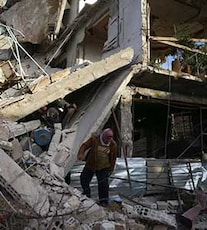 'Waiting Our Turn To Die,' Say Residents As Bombs Fall On Syrian Town