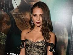 Alicia Vikander Looks Lara Croft Chic At <i>Tomb Raider</i> Premiere