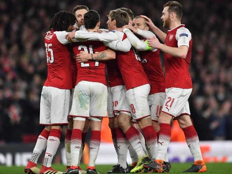 Welbeck Double Helps Arsenal Beat AC Milan, Dortmund Dumped Out