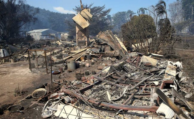 At least 70 homes destroyed as ferocious 'firestorm' rips through Australian town