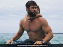 "Watch Chris ""Thor"" Hemsworth Surf With Daughter Like A Boss"