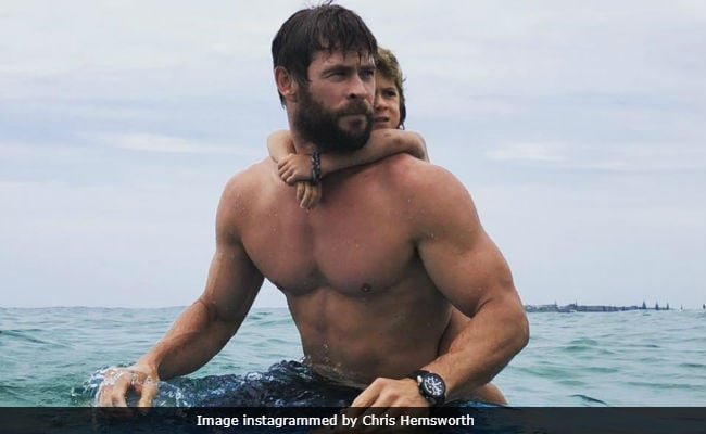 Watch Chris 'Thor' Hemsworth Surf With Daughter Like A Boss