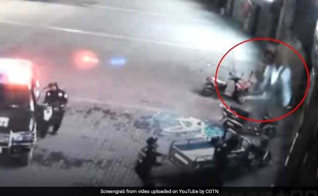 Watch Dramatic Moment Hero Cop Catches Woman Falling Off Building