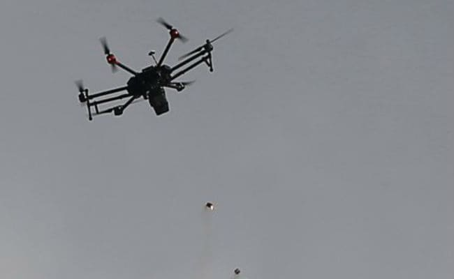 drones dropping tear gas gaza reuters