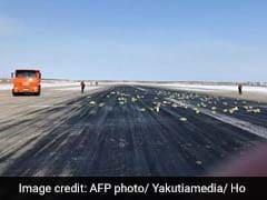 Gold, Platinum Bars Spill Across Russian Runway As Plane Door Flies Open