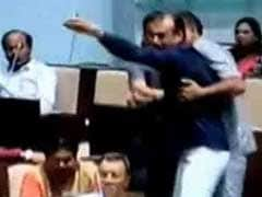 Chaos In Gujarat Assembly, Congress Lawmaker Throws Mic At BJP Leader