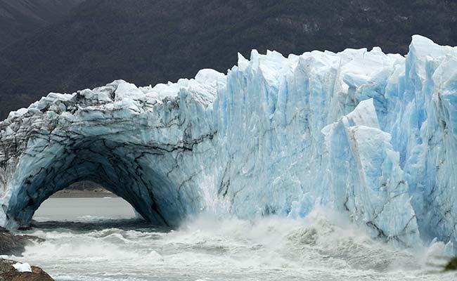 Ice Bridge In Argentine Glacier Collapses