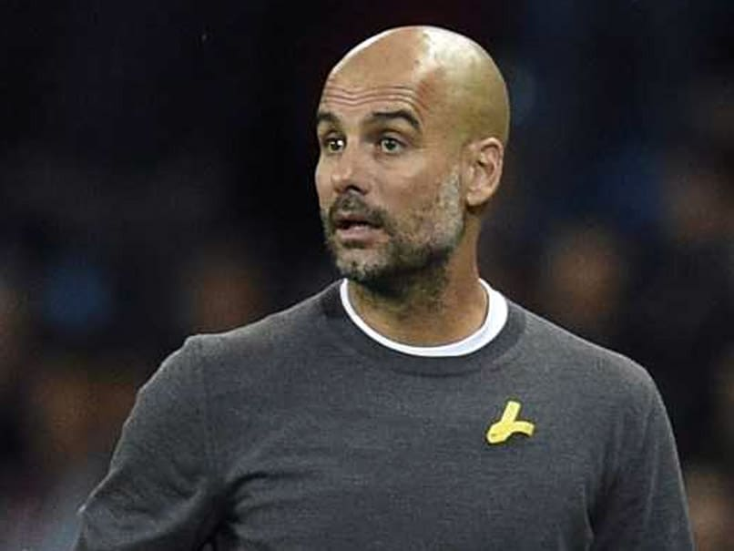 Guardiola fined £20000 for wearing yellow ribbon