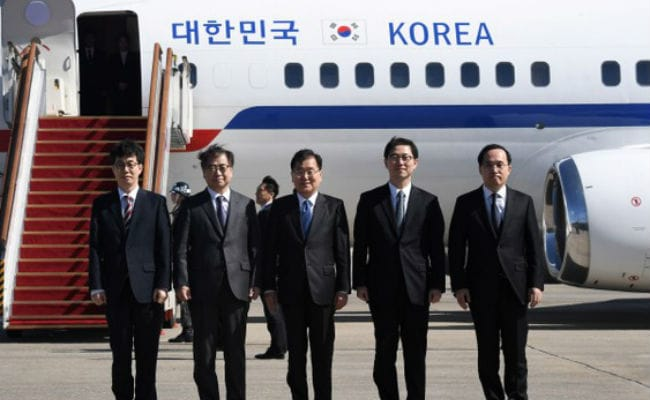 South Korean envoys in historic trip to North, meet Kim
