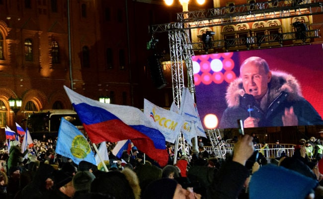 Vladimir Putin Cruises To Victory In Russia, Tells Supporters: 'Success Awaits Us'