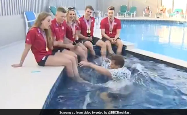 BBC Reporter Falls Into Swimming Pool During Live Interview. Watch