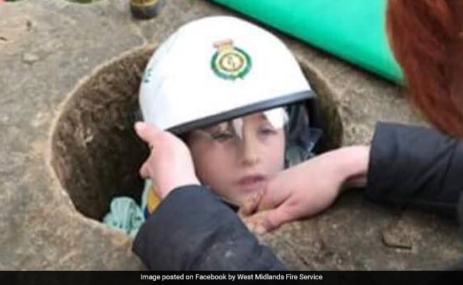 Boy, 7, Tries To Recreate Pic From When He Was 2, Gets Stuck In Hole