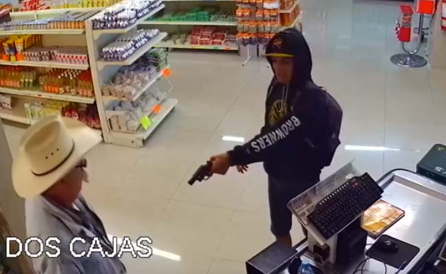 A Gunman Held Up A Butcher Shop. Enter Man In Cowboy Hat