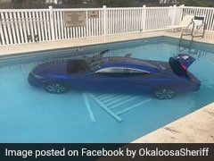 Woman Forgets To Put Car In Park. It Rolls Into Pool With Family Inside