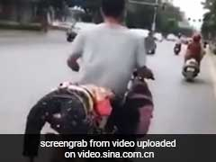 Caught On Camera: She Refused To Go To School, So Dad Tied Her Onto Bike