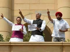 Congress Lawmakers Protest On Parliament Roof, Demand Compensation For Families Of Iraq Victims