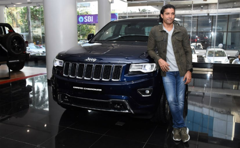 Farhan Akhtar poses with his Jeep Grand Cherokee in the True Blue colour
