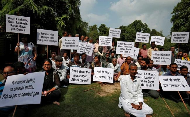 journalists india protest reuters