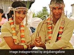 Milind Soman Ankita Konwar Got Married Watch Pics And Viral Videos
