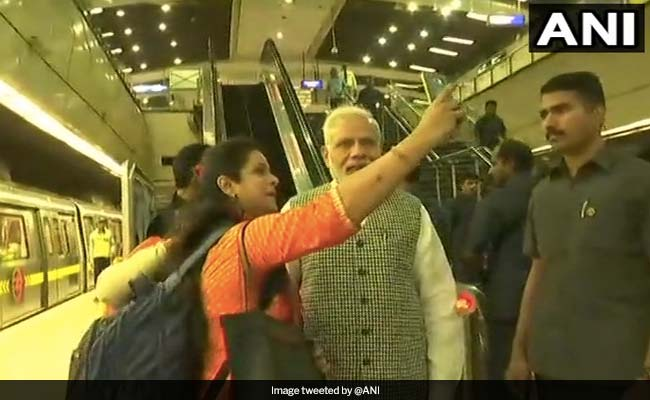 PM Narendra Modi seen here with a passenger taking a selfie at a Delhi metro station