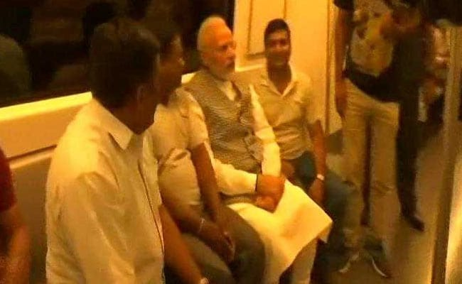 PM Modi Takes Metro During Rush Hour Surprised Riders Get Selfies