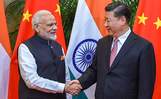 India, China agree to keep border peace at 'milestone' informal summit