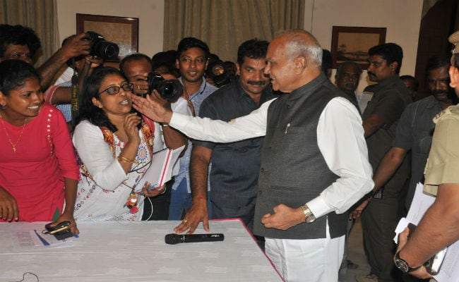 Uproar after TN governor pats senior journalist on cheek