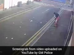 Wind Blows Away Robber's Stolen Cash, He Helplessly Chases After. Watch