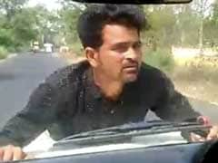 Watch: UP Government Official Drives For 4 Km As Man Clings On To Bonnet
