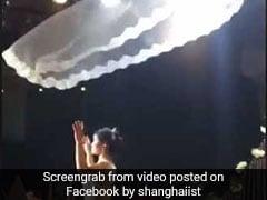 China's Latest Viral Trend Involves Flying Veils. Wedding Inspiration, Anyone?